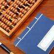 Chinese book , abacus and writing brush — Stock Photo #35128627