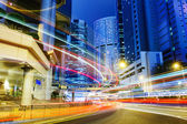 Busy traffic in city at night — Stock Photo