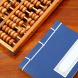 Chinese book , abacus and writing brush on the table — Stock Photo