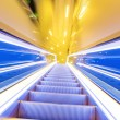 Movement of diminishing hallway escalator — Stock Photo #35366915