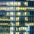 Modern office building at night — Stock Photo