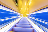 Movement of diminishing hallway escalator — Стоковое фото