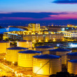 Oil tanks plant during sunset — Stock Photo