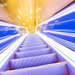 Stock Photo: Movement of diminishing hallway escalator