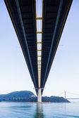 Low angle of suspension bridge in Hong Kong — Stock Photo