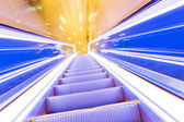 Movement of diminishing hallway escalator — Stok fotoğraf