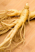 Fresh Ginseng on the wooden background — Stock Photo