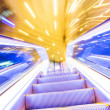 Movement of diminishing hallway escalator — Stock Photo