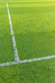 White line on the green turf for football court — Stock Photo