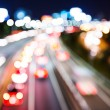 Blurred unfocused highway view at night — Stock Photo