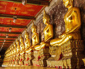 Golden buddha in temple — Stok fotoğraf