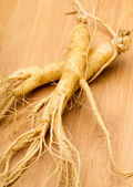 Fresh Ginseng on the wooden background — Photo