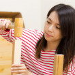 Stock Photo: Asiwomusing hammer for assembling