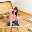 Asiwomassembling new chair with instruction — Stock Photo #36614761