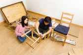 Asian couple assembling furniture for new house — Stock Photo
