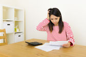 Asian woman worries about the expenditure — Stock Photo