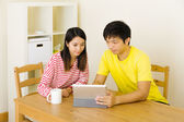 Asian couple using concentrate on the tablet — Stok fotoğraf