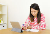 Asian woman learning through digital tablet — Stock Photo