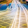 Road in city light trails — Stock Photo