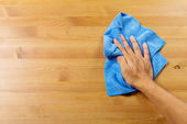 Cleaning table by hand — Stockfoto