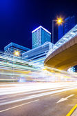 Busy traffic and modern building — Stock Photo