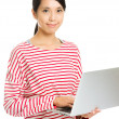 Asian woman using laptop — Stock Photo
