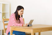 Asian woman watching movie on digital tablet — Stockfoto