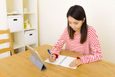 Asian woman copy from digital tablet — Stock Photo