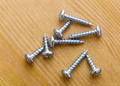 Screws on wood — Stock Photo