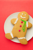 Gingerbread cookies with red background — Stock Photo
