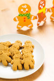 Gingerbread man and christmas card — Stock Photo