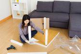 Woman assembling furniture — Stock Photo