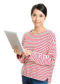 Woman holding laptop isolated on white — Stock Photo