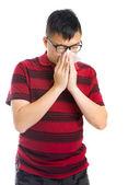 Asian man sneezing — Stock Photo