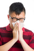 Asian man sneezing isolated on white — Stock Photo