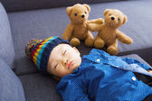 Asian baby boy sleeping with doll — Stock Photo