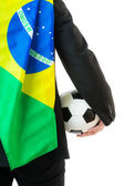 Businessman holding soccer ball and brazil flag — Stock Photo