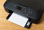 Domestic printer and paper — Stock Photo