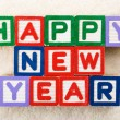 Happy new year toy block — Stock Photo #38284733