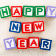Happy new year toy block — Stock Photo #38284849