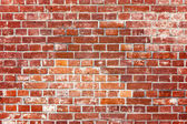 Brick wall in red — Stockfoto