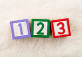 123 toy block with towel background — Stock Photo