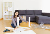 Woman assemble furniture — Stock Photo