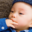 Asian baby boy with finger in mouth — Stock Photo #38450257