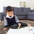 Asian little boy drawing picture at home — Stock Photo