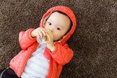 Baby boy feeding with milk bottom — Stock Photo
