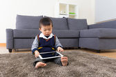 Asian baby boy using tablet at home — Foto de Stock