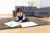 Asian baby boy drawing picture at home — Stockfoto