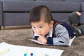 Little boy crawling for drawing — Stock Photo
