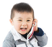 Asian baby boy talk to mobile — Stock Photo
